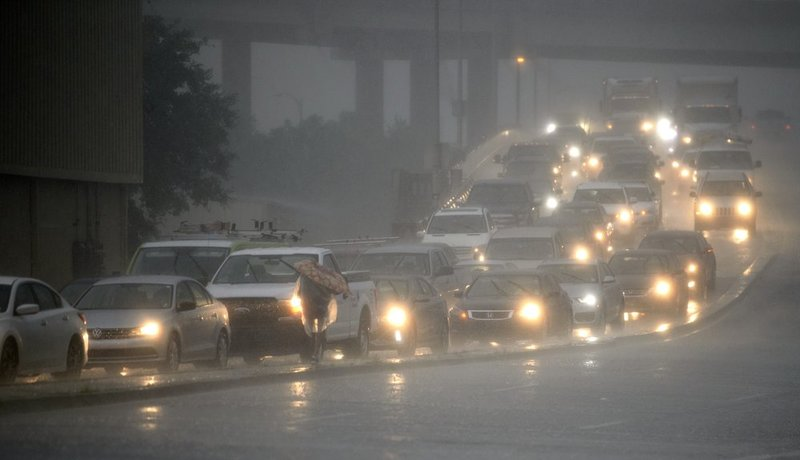 Traffic backs up as rain come down at Airline Drive and S. Carrollton Ave. in New Orleans, as severe thunderstorms cause street flooding Wednesday, July 10, 2019. (Max Becherer/The Advocate via AP)