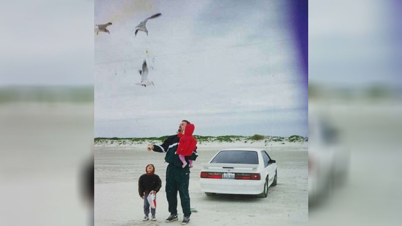 Wesley Ryan is seen here with his beloved 1993 white Ford Mustang GT and his family. He sold the car in 2004 to pay for his wife's medical bills as she battled cancer.