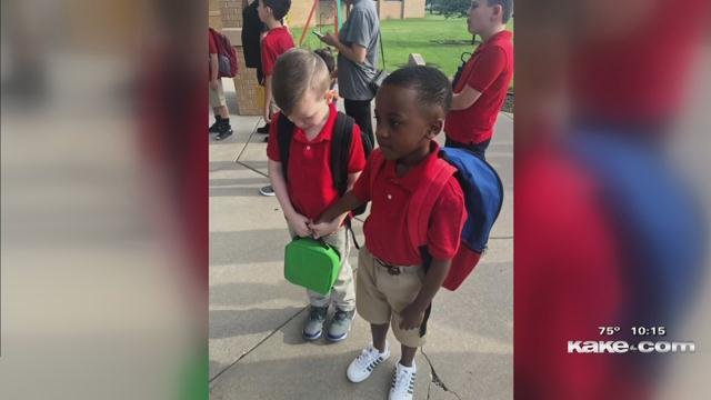 Photo of 8-year-old boy reaching out a hand goes viral