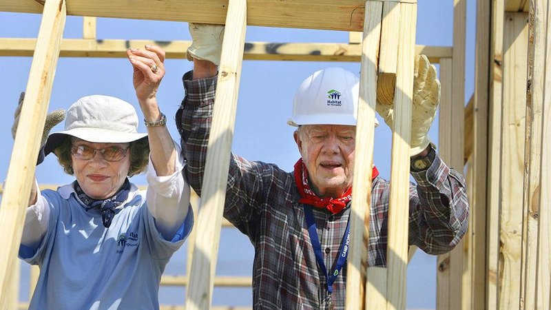 This file photo shows former President Jimmy Carter and former first lady Rosalynn Carter raising a wall as they help build a Habitat for Humanity house. (AP Photo/Alex Brandon)