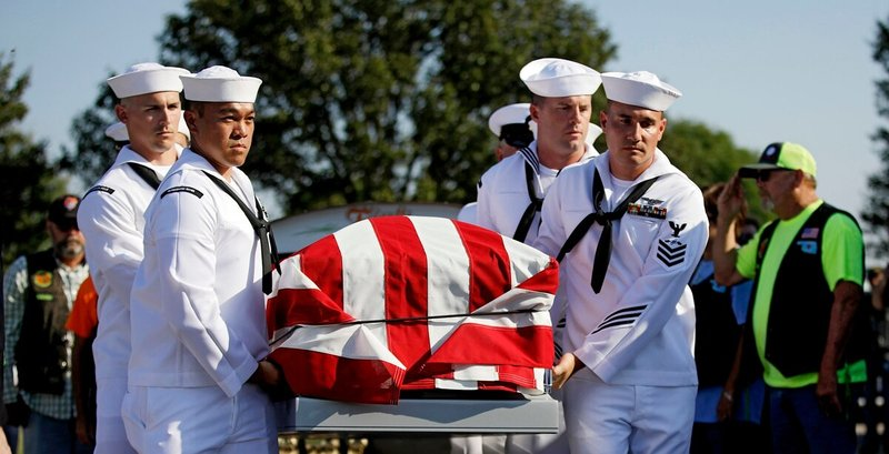 Sailors carry the casket of World War II veteran Herman White during his funeral on Wednesday. (Mike Simons/Tulsa World via AP)