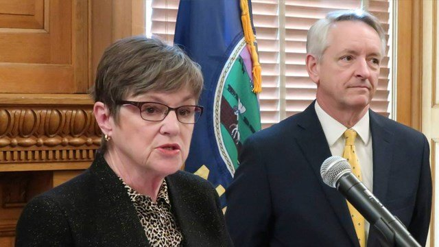 Kansas Gov. Laura Kelly, left, announces the nomination of Labette County District Judge Jeffry Jack for the state Court of Appeals. (AP Photo/John Hanna, File)