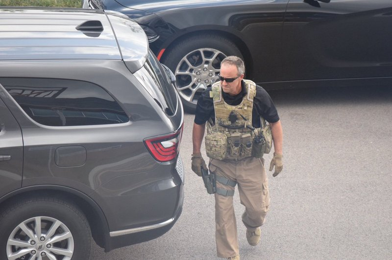Heavy security, in uniform and plains clothes, surrounded the attorney general as he stopped for a visit in Wichita.