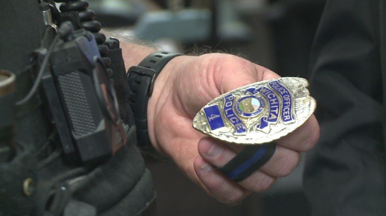 Polishing badges ahead of Detective Young's funeral