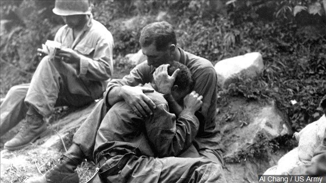 A grief stricken American infantryman is comforted by another soldier, Photo Date: 8/28/1950