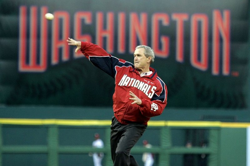 In this April 14, 2005, file photo, President George W. Bush throws out the ceremonial first pitch at the Washington Nationals home opener in Washington. The Nationals play the Arizona Diamondbacks