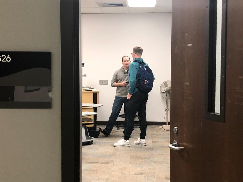 Wichita mayor-elect Brandon Whipple speaking with a student after his Wednesday morning government class at Wichita State University.  Whipple has taught part-time at WSU for the last few years.