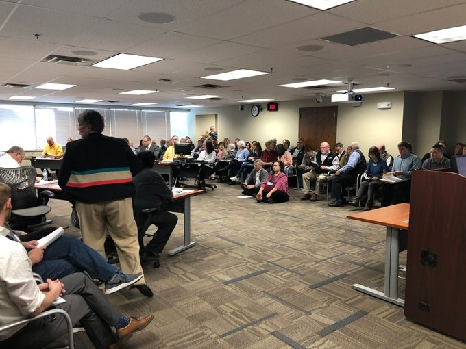 Neighbors pack into a Metropolitan Area Planning Commission meeting on Thursday, December 5th, to voice their opposition to a planned events center.