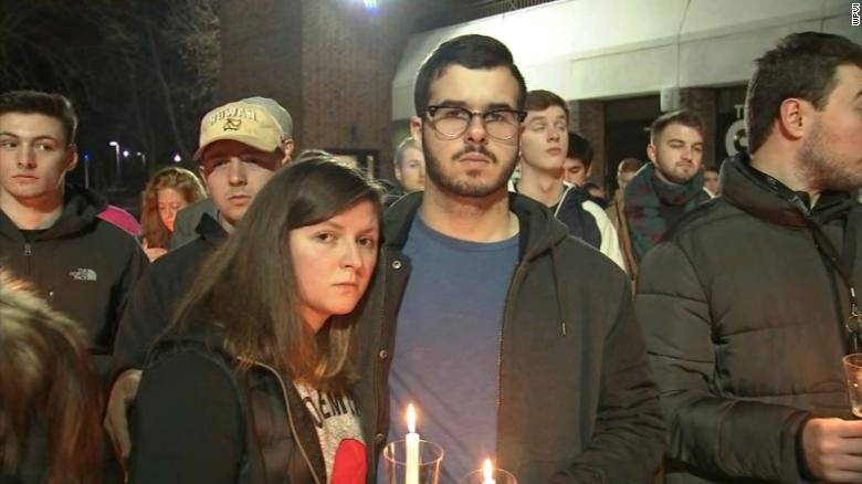 Rowan University students attend a vigil on campus Friday in honor of those who have died by suicide.