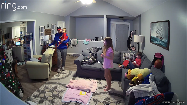 Jake Norris and his family as seen through the Ring security camera in his living room  as he realized where the strange voice was coming from.