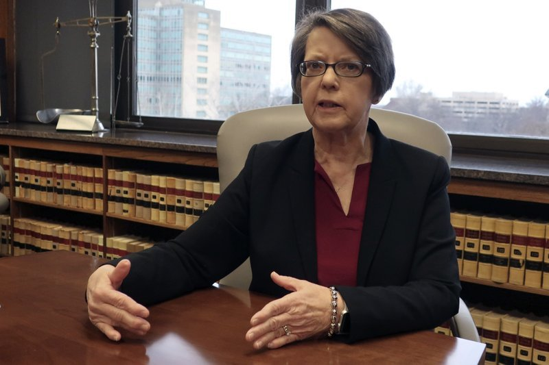 Kansas Supreme Court Chief Justice Marla Luckert answers questions during an interview with The Associated Press, Friday, Dec. 20, 2019, in the conference room where justices discuss cases, in Topeka, Kan.