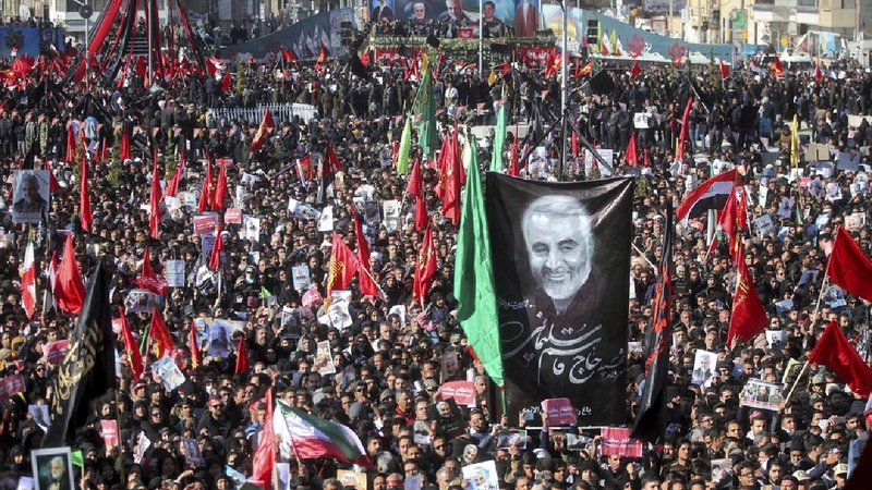 Mourners attend a funeral ceremony for Iranian Gen. Qassem Soleimani