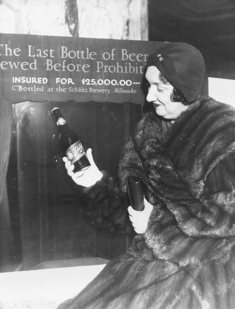In this Dec. 29, 1930, file photo Rae Samuels holds the last bottle of beer that was distilled before prohibition went into effect in Chicago.