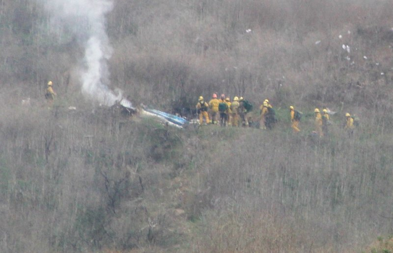 One of several photos former Wichitan Curtis Caster took of the helicopter crash scene just up the road from his new home in Calabasas, CA.