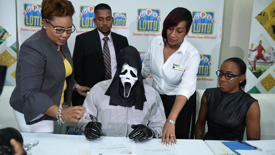 Lottery winner claims prize in 'Scream' mask to hide identity