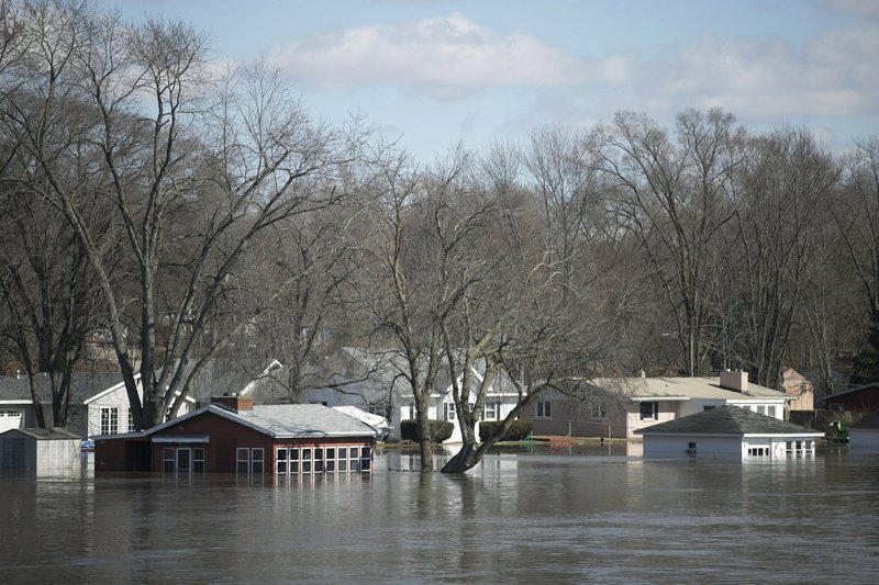 Homes flood as Missouri River overtops, breeches levees