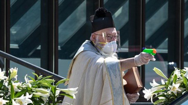 Priest Uses Squirt Gun To Shoot Holy Water So He Can Bless Peopl
